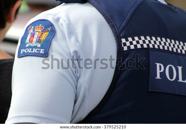 Close up of a New Zealand police officer's uniform and badge