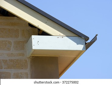 Close up of a newly constructed home fascia on a stone house