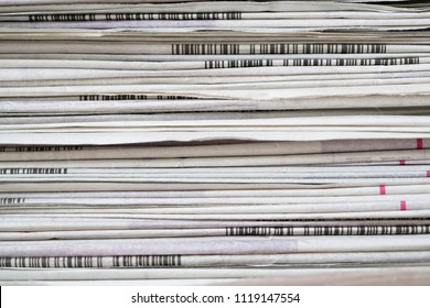 close up newspapers folded and stacked background on the table