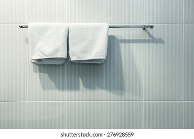 Close up of nice white towels on Clothes line in the bathroom