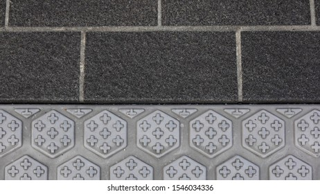 Close up of non-slip floor. Black rubber and hexagon shaped bumps tile floor.