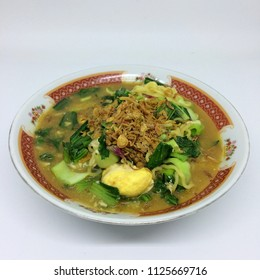 Close up Noodles with vegetables and scramble egg / mie rebus