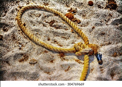close up of a noose on the sand in hdr tone mapping effect