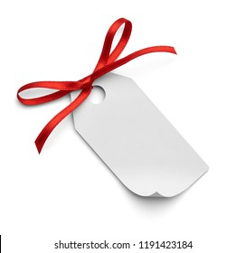 close up of a note card with red ribbon bow on white background