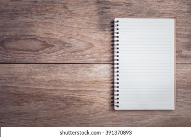 Close up notepad / lined paper on wooden table top view
