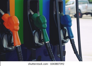 Close up nozzle fuel for fill oil into car tank at pump gas station, saving money and energy for transport, transportation technology, manage for success business concept