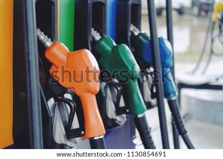Close Nozzle Fuel Fill Oil Into Stock Photo (Edit Now) 1130854691