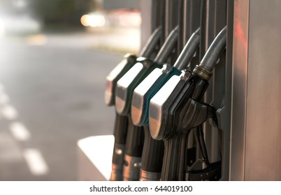 Close up nozzle fuel at gas station