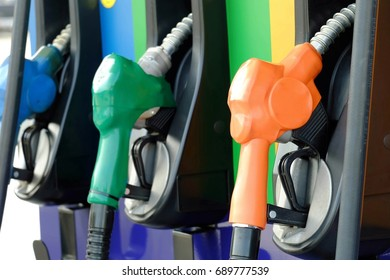close up nozzle fuel in gas station, transport and business concept