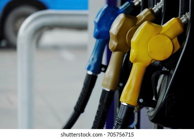 close up nozzle fuel in pump gas station, transport and business concept