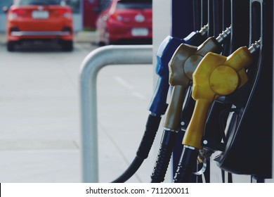 close up nozzle fuel in pump gas station, transport ans business concept