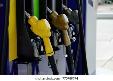close up nozzle fuel in pump gas station, saving money and energy for transport, success business concept