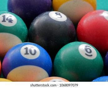 Close up of numbers 6, 9 and 10 of american pool balls. American pool balls with some usage marks.