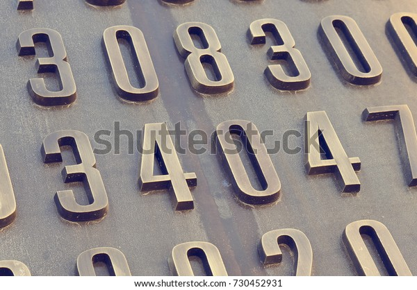 Close up of numbers on the Enigma Code Breakers monument on October 2017 in Poznan, Poland