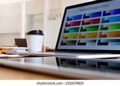 Close up object creative designs concept. Creative designs workplace with laptop, table, pencil color and color bar example on the table.