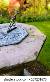 Close up of an octagon sundial in an English country garden.
