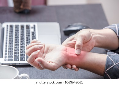 close up office woman pain at right wrist, case woman woking at table and pain at right wrist because of hard work, office syndrome concept