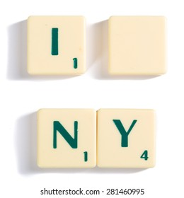 Close up Off-White Wooden Scrabble Letter Tiles for I Blank NY Concept, Isolated on White Background.