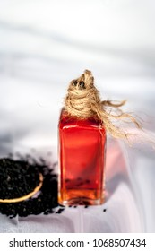 Close up of oil of kalonji with ayurvedic herb ajwain isolated on white used to remove cough and for weight loss.