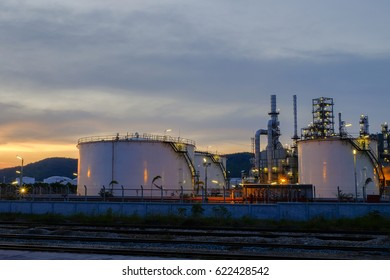 Close up Oil refinery,Petroleum industry at night, sunset background.