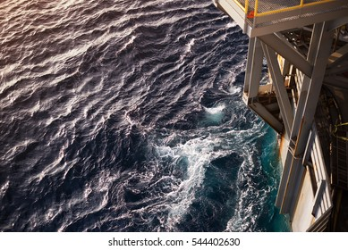 Close up oil rig bow while towing in the blue ocean