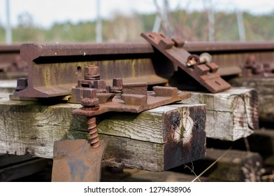 Close up of old abandonned rusty rails with wooden sleepers.