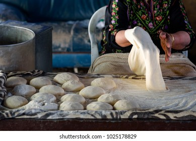 Close up of old Arab woman hands kneading fresh dough for Taboon bread or Lafahi is a Middle Eastern  flatbread. It is also called lafa or Iraqi pita and esh-tanur.Real people, authentic image.