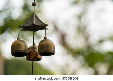 Close up Old Bell Tinkling wind chimes Thai Style.