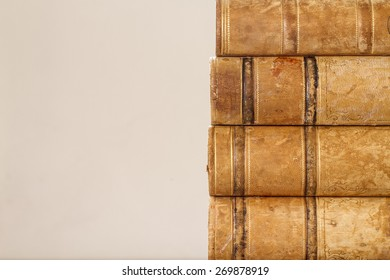 Close up of old books with weathered leather backs