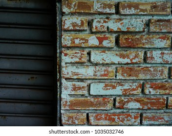 Close up of old brick wall and metal door, vintage style
