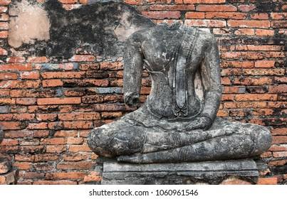 close up old buddha figure on Ayuthaya,Thailand. Ancient religion object