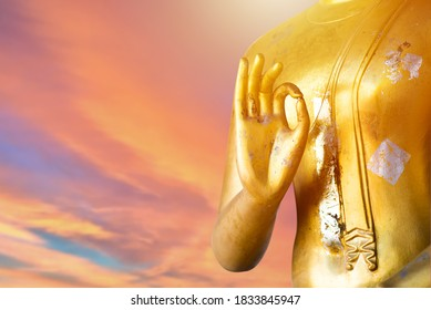 Close up old Buddha statue with raw of Brass. Hand of buddha statue with two hand stamp with chest. Believe, Culture, Traditional. Buddhist believe and merit. Calm and meditation concept. Copy space.