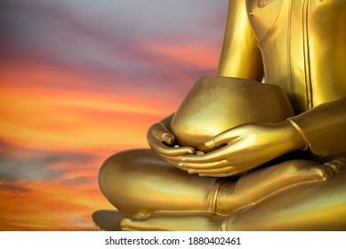 Close up old Buddha statue with raw of Brass. Hand of buddha statue holding monk's alms bowl with line. Believe, Culture. Buddhist believe and merit. Calm and meditation concept. Copy space.