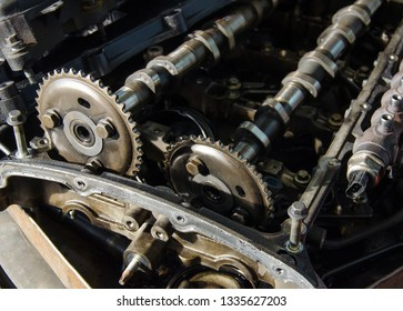 Close up old camshafts of disassembled engine under repair.