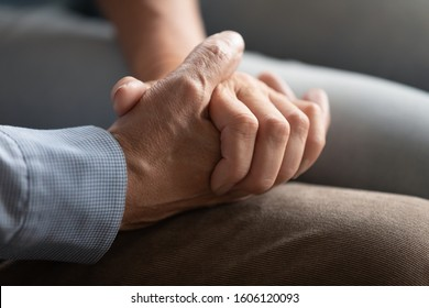 Close up of old couple arms, people hold hands enjoy dating two lonely souls met each other on sunset of their days. Being together at difficult life period such as disease or personal problem concept