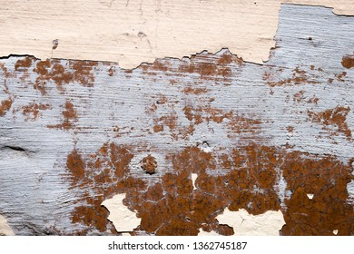 Close up of old damaged cracked wall with peeling paint. Abstract texture background