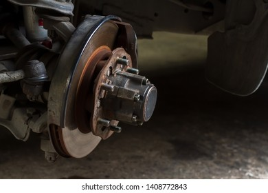 Close up old disk break with wheel hub and auto hub lock of the 4x4 car in garage shop and waiting the mechanical fitter checking list for repair and maintenance background.