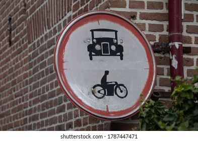 Close up of old dutch traffic sign or signpost. Do not drive in, cars and motorbikes. T-Ford and Harley Davidson. Part of a serie.