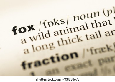Close up of old English dictionary page with word fox