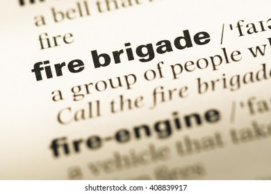 Close up of old English dictionary page with word fire brigade