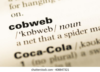 Close up of old English dictionary page with word cobweb