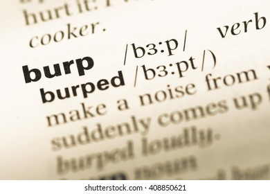 Close up of old English dictionary page with word burp