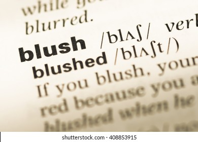 Close up of old English dictionary page with word blush