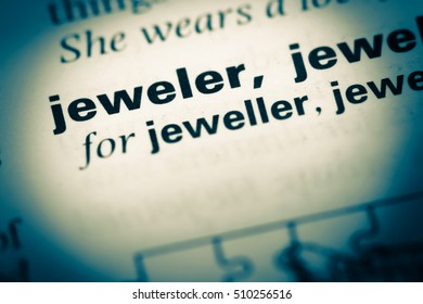 Close up of old English dictionary page with word jeweler