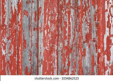 Close Up of an Old Exterior Wood Wall with Peeling Red Paint