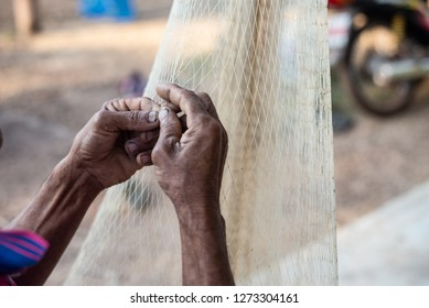 Close up old hand fisherman and hard work.