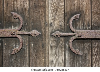 A close up of old iron door hinges