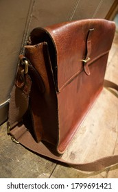 Close up of old leather satchel with closed buckle