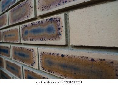 Close up of an old light brown brick wall.