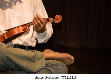 Close up Old man playing violin
